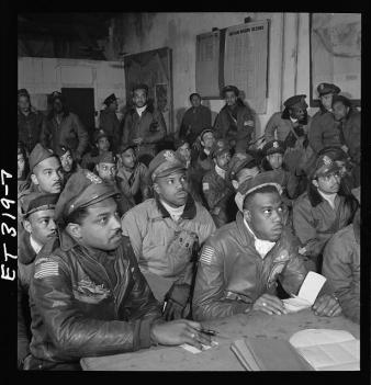 [Photograph of several Tuskegee airmen attending a briefing in Ramitelli, Italy, March 1945] by Toni Frissell LOC